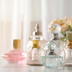 Many different perfume bottles on dressing table, space for text