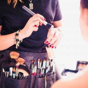 Makeup artist doing makeup for girl indoor